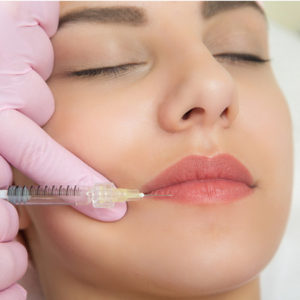 Beautiful woman getting injectable