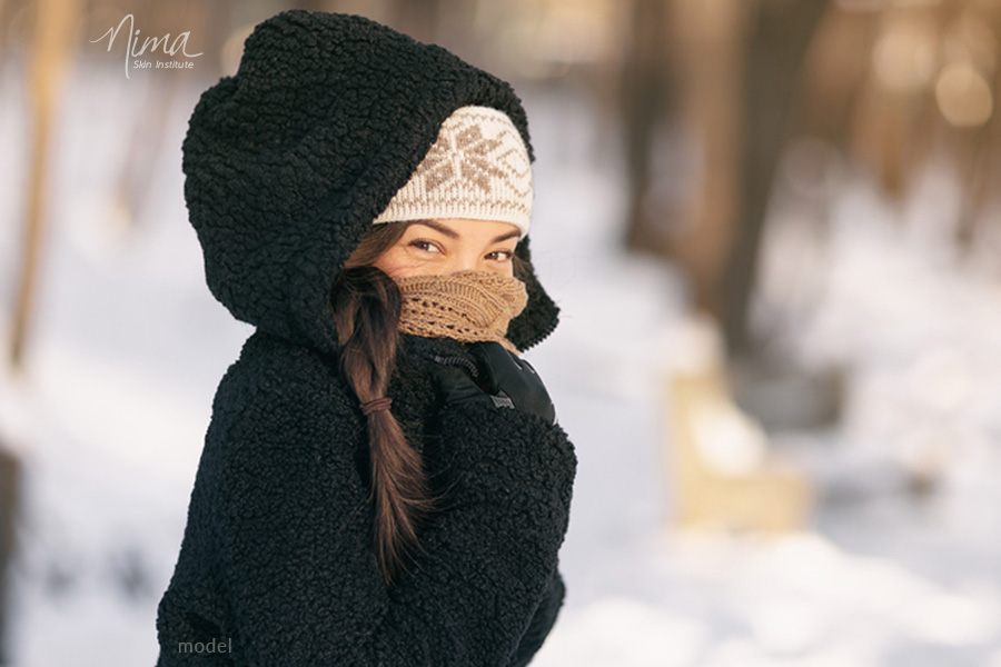 Photo of woman bundled up against the cold